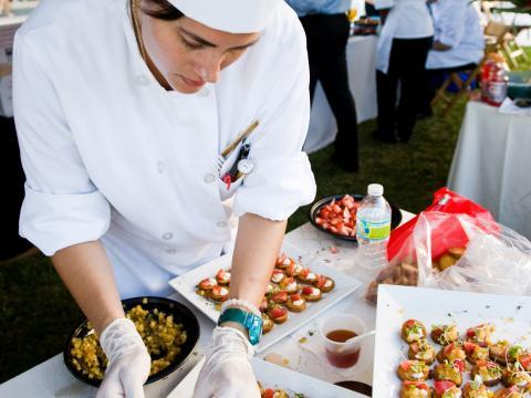 A chef preparing samples at Flavor Palm Beach in Florida